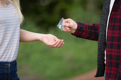 Teen Drug Use First Hand: Young Woman Buying from Dealer