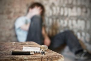 Young Man Struggling Through Heroin Withdrawal