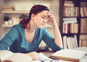 Woman in Library Exhibiting Common Problems College Students Face